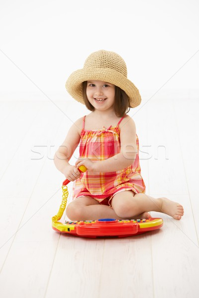Little girl playing with toy instrument Stock photo © nyul