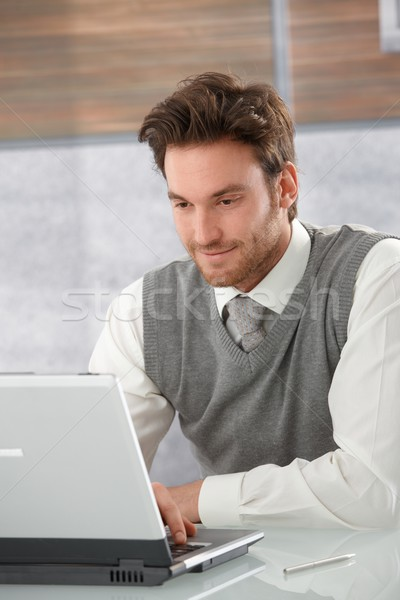 Stock photo: Young businessman browsing internet smiling