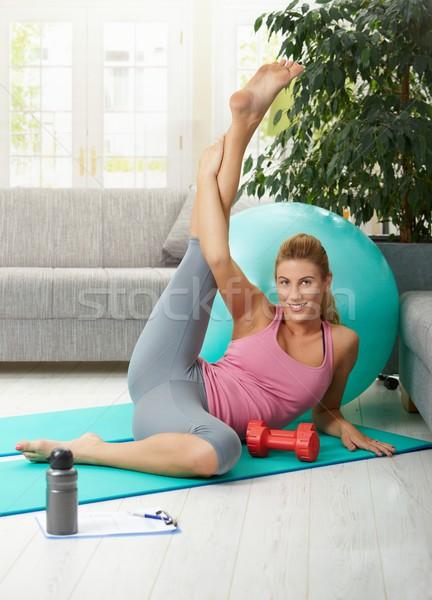 Woman streching her leg Stock photo © nyul