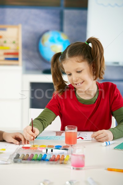 Schoolgirl painting in art class at elementary school Stock photo © nyul