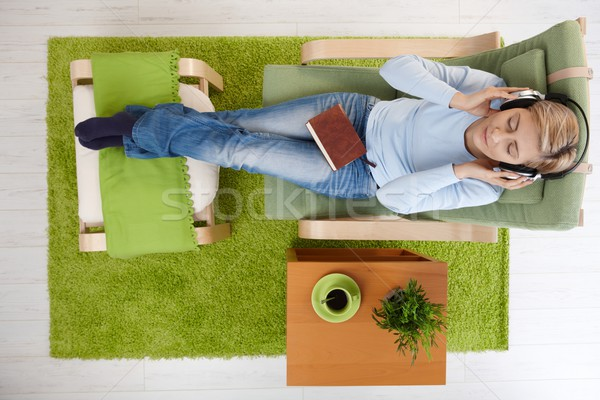 Woman listening to music at home Stock photo © nyul