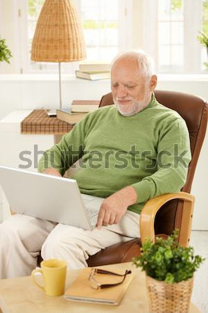 Stock photo: Old man measuring blood pressure at home
