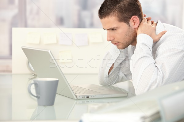Young man looking tired in office Stock photo © nyul