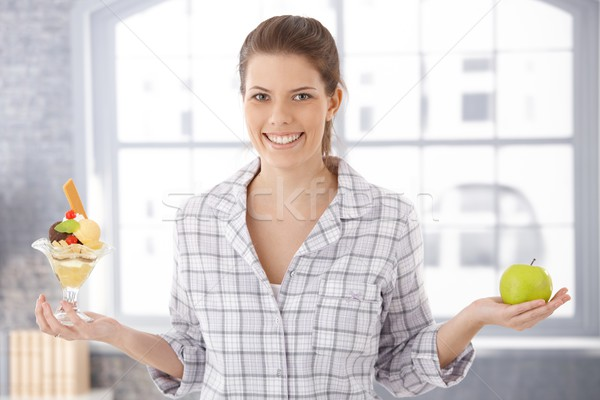 Happy woman holding icecream cup and apple Stock photo © nyul