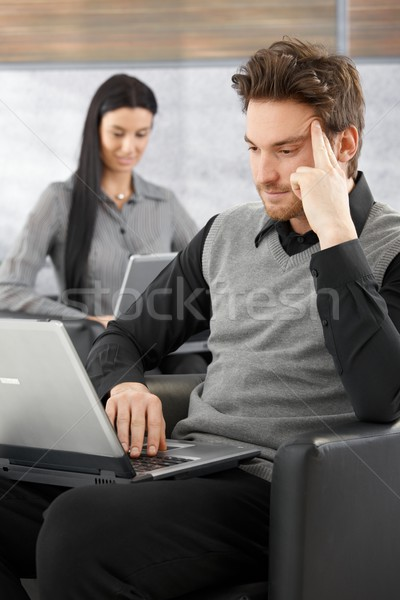Young businessman working on laptop Stock photo © nyul