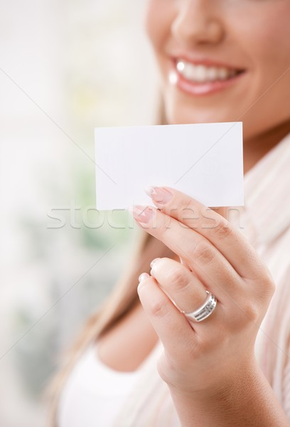 Beautiful young woman holding card Stock photo © nyul