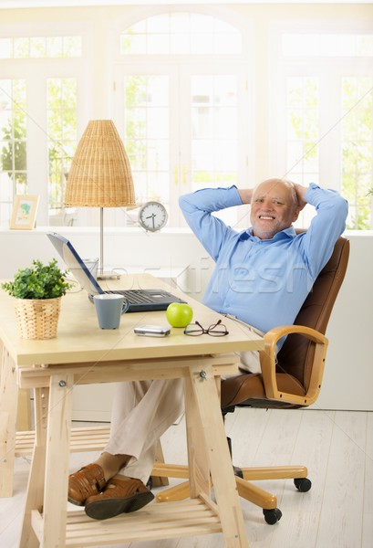 Portrait of cheerful old man in his study Stock photo © nyul