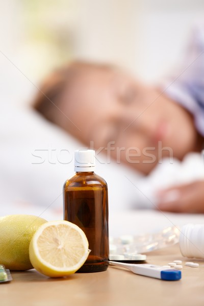 Vitamins medicines for flu woman in background Stock photo © nyul