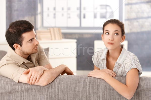 Young couple sitting on sofa in bad mood Stock photo © nyul
