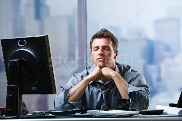 Businessman focusing on problems in office Stock photo © nyul