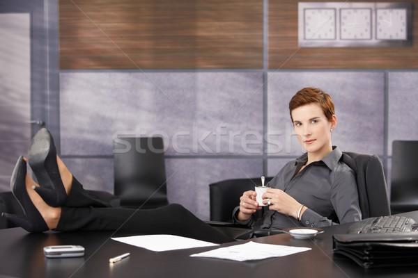 Cool businesswoman on coffee break Stock photo © nyul