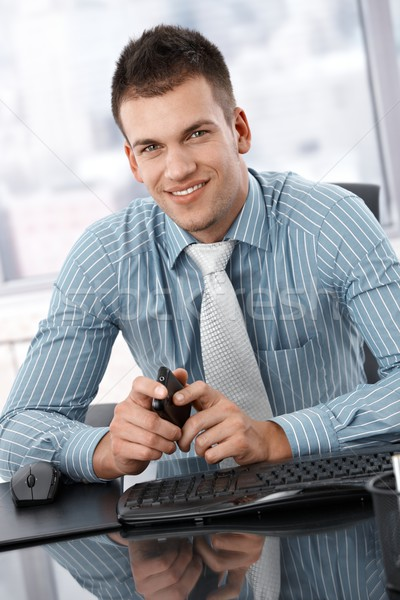 Portrait of young businessman sitting at desk Stock photo © nyul