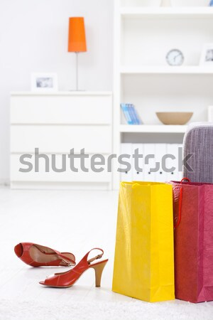 Stock photo: Taking off shoes after shopping
