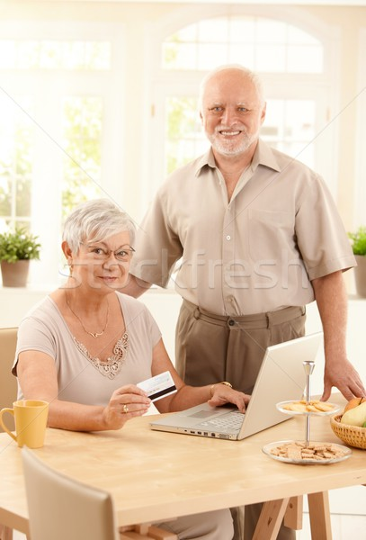 Senior couple purchasing on Internet Stock photo © nyul