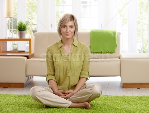 Woman on living room floor Stock photo © nyul