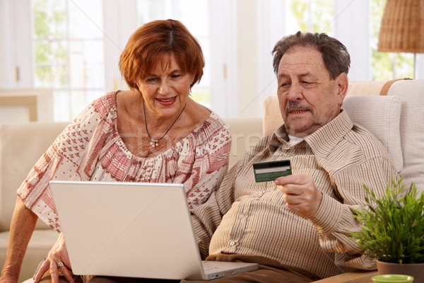 Elderly couple shopping online Stock photo © nyul