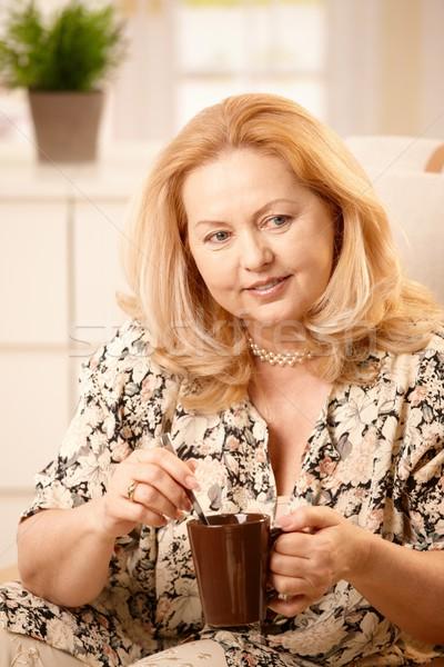 Stock photo: Senior woman drinking coffee