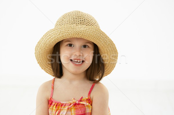 Portrait of little girl in summer straw Stock photo © nyul