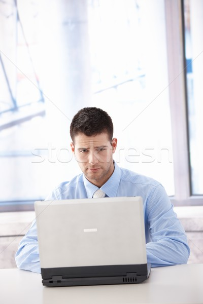Businessman looking at laptop screen troubled Stock photo © nyul