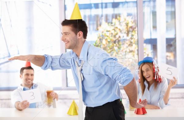 Young man having fun at office party Stock photo © nyul