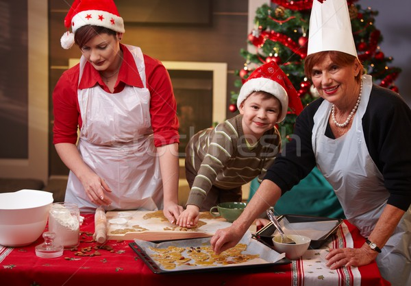 Grandmother, mum and son with christmas cake Stock photo © nyul