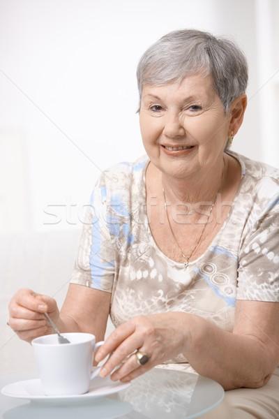 Stock photo: Happy senior woman drinking coffee