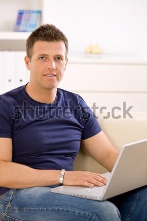 Man using laptop Stock photo © nyul