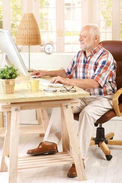 Senior man working in his study Stock photo © nyul