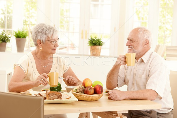 Happy elderly couple having breakfast Stock photo © nyul