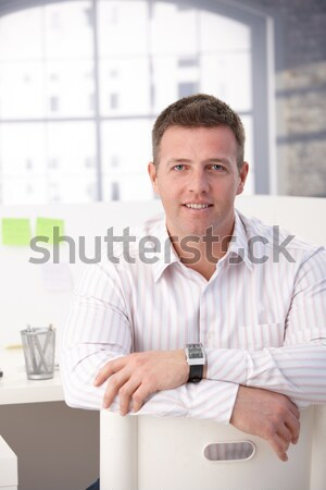 Stock photo: Middle aged office worker having break in office