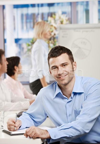 ストックフォト: ビジネスマン · ノート · 会議 · 幸せ · 座って