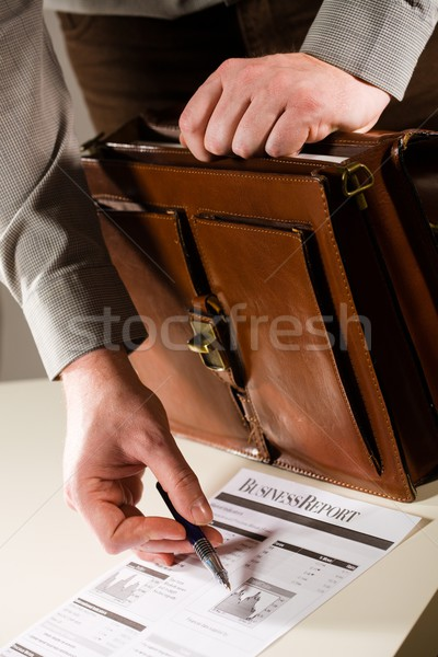Businessman pointing at financial report Stock photo © nyul