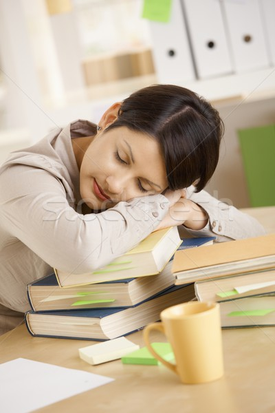 Tired student resting on pile of books Stock photo © nyul