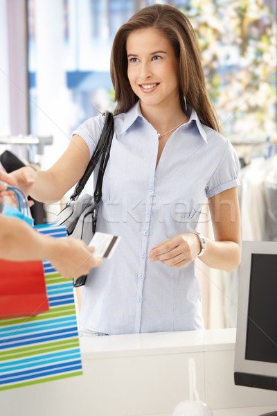 Woman purchasing clothes in shop Stock photo © nyul