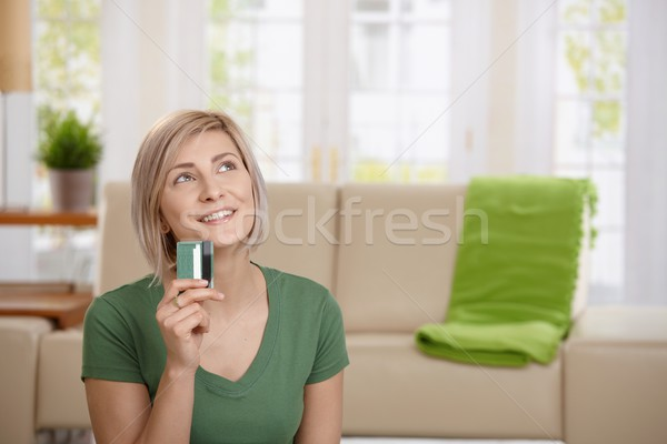 Woman thinking about shopping Stock photo © nyul