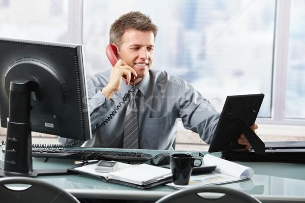 Happy businessman on phone calling family Stock photo © nyul