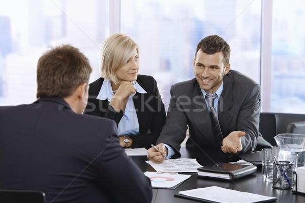 Сток-фото: бизнесмен · улыбаясь · заседание · документа