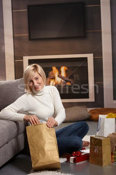 Kadın hediyeler zemin ev şömine Stok fotoğraf © nyul