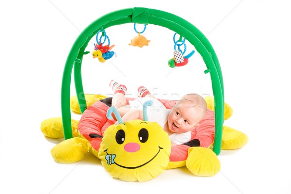 Bebé gimnasio aislado feliz jugando juguete Foto stock © nyul