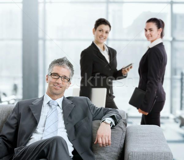 Biznesmen lobby portret posiedzenia sofa biuro Zdjęcia stock © nyul