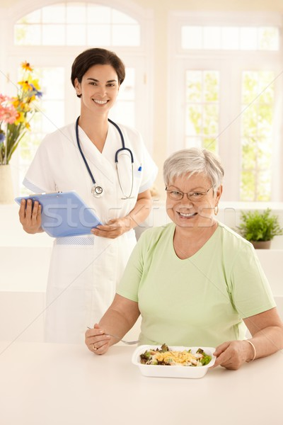 Healthy elderly woman eating salad Stock photo © nyul