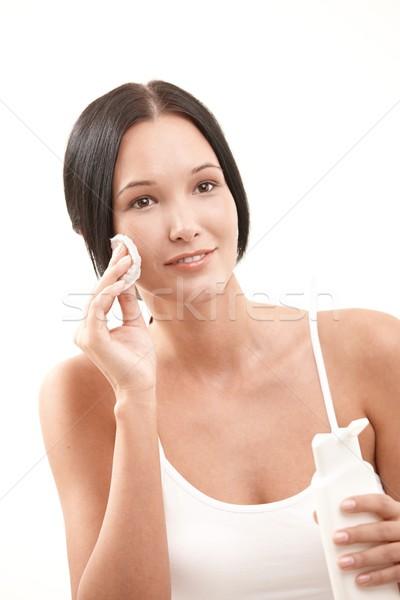 Сток-фото: красивая · женщина · очистки · лице · хлопка · бутылку