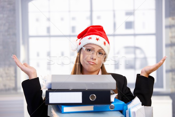 Young woman in santa hat having too much work Stock photo © nyul