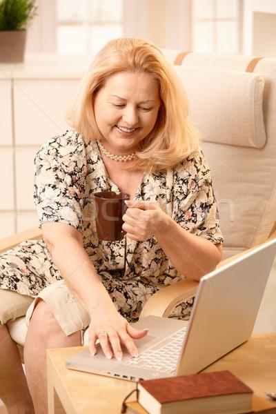 Stock photo: Senior woman with laptop