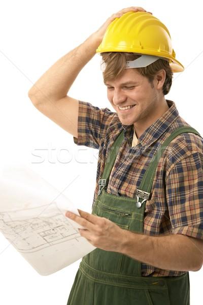 Handwerker schauen Grundriss lächelnd isoliert Stock foto © nyul