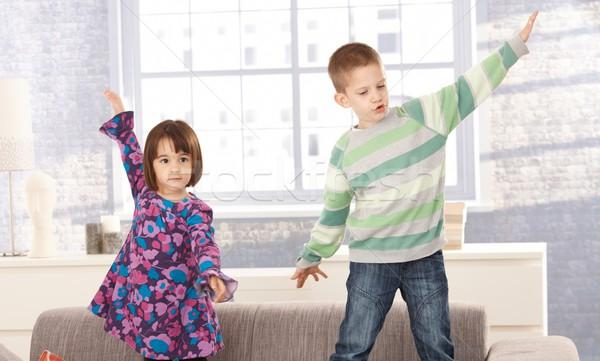Enfants jouer canapé ensemble bras large Photo stock © nyul