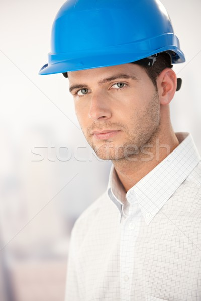 Stock photo: Portrait of goodlooking young man in helmet
