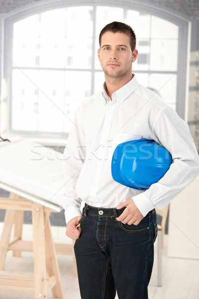 Young architect standing in bright office Stock photo © nyul