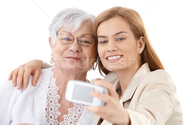 Mother and daughter taking photo of themselves Stock photo © nyul