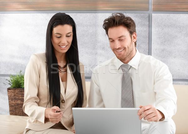 Happy professionals using laptop Stock photo © nyul